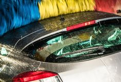 Modern Car in the Car Wash. Modern Car in the Automatic Brush Car Wash. Closeup Photo. Vehicle Cleaning stock image