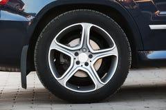 Modern car wheel on light alloy disc, closeup Royalty Free Stock Image