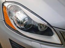 Modern car xenon headlight. Close-up of Volvo XC60 headlight Royalty Free Stock Photo