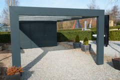 Modern carport car garage parking. Made from black metal and glass stock photography