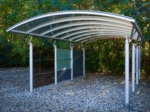 Modern carport car garage parking. Made of silver metal and glass royalty free stock photo