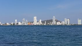 Modern Cartagena along the sea shoreline beaches. Scenic view from the sea harbor on the modern multistory buildings in Cartagena, Colombia Stock Photos
