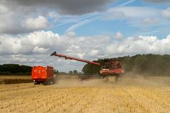 Modern case combine harvester cutting crops Royalty Free Stock Photography