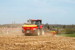 Modern case tractor drilling seed in field Royalty Free Stock Photos