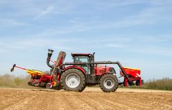 Modern case tractor drilling seed in field Royalty Free Stock Images