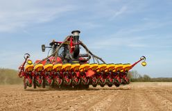 Modern case tractor drilling seed in field Royalty Free Stock Photo