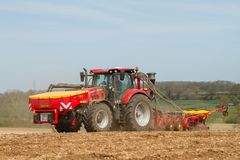 Modern case tractor drilling seed in field with vaderstad drill Stock Photography