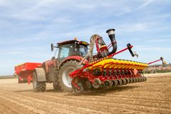Modern case tractor drilling seed in field with vaderstad drill Stock Images