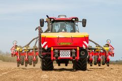 Modern case tractor drilling seed in field with vaderstad drill Royalty Free Stock Photos