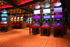 Modern casino hall with game machines Royalty Free Stock Photos