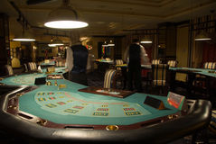 Modern casino interior. Modern and beautiful casino interior, focus of poker playing tables Stock Photos