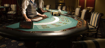 Modern casino interior. Modern and beautiful casino interior, focus of poker playing tables Stock Images