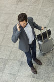 Modern casual business man on cell phone in hall airport. Top Vi Stock Image