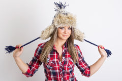Modern casual woman wearing fashionable winter hat Royalty Free Stock Image