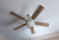 Modern ceiling electrical fan in motion Stock Photos