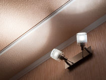 Modern ceiling lights. Two modern ceiling lights mounted on a wall Stock Photography