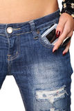 Modern cellphone sticking out of a jeans Stock Image