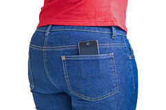 Modern cellphone sticking out of a jeans pocket Stock Images