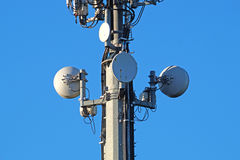 Modern Cellular Tower - Communication  on Blue Sky. Vertical Photography. Stock Photos