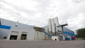 Modern Cement factory. Cement factory machinery on a clear blue day stock footage