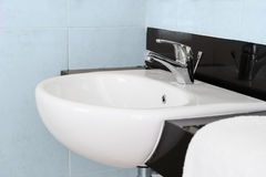 Modern ceramic hand wash basin. With chrome water mixer tap in hotel washroom interior Royalty Free Stock Photos