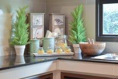 Modern ceramic kitchenware and utensils on black granite counter top Stock Photo