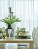 Modern ceramic tableware in green color scheme setting on dining table Stock Image