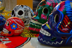 Modern ceramiques, blue, green, red and white skull Stock Photos