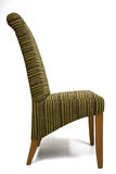 Modern chair. Modern design, upholstered in green-brown stripped textile Royalty Free Stock Photo