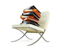 Modern chair and folders Stock Photography