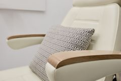 Modern chair for massage. Modern massage chair for healthcare and relaxation in beauty salon royalty free stock images