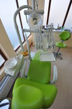 Modern chair and tools in dentists office Stock Images