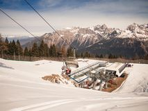 Modern chairlift that transports skiers to the tops of the ski s Royalty Free Stock Photography
