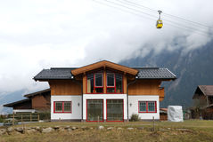 Modern chalet under cable road. Modern chalet under the cable road in Tirol village royalty free stock photos