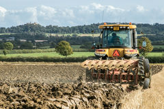 Modern Challenger  tractor cultivating English crop field Stock Image