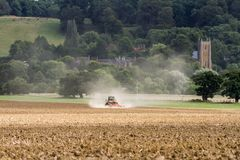 Modern Challenger  tractor cultivating English crop field Stock Photo