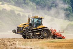Modern Challenger  tractor cultivating English crop field Royalty Free Stock Images