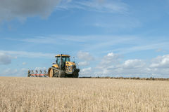 Modern Challenger tractor ploughing English crop field Stock Photography