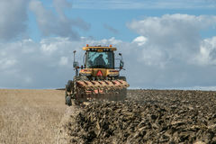 Modern Challenger tractor ploughing English crop field Stock Photo