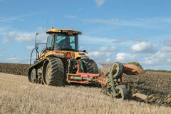 Modern Challenger tractor ploughing English crop field Royalty Free Stock Photography