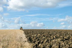 Modern Challenger tractor ploughing English crop field Stock Images