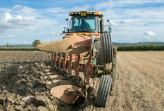 Modern Challenger tractor ploughing English crop field Royalty Free Stock Photos