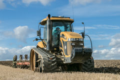 Modern Challenger tractor ploughing English crop field Stock Image