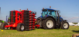 Modern Valtra tractor with cultivator  Royalty Free Stock Image