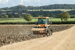 Modern Challenger tractor ploughing English crop field Royalty Free Stock Image