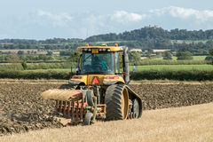 Modern Challenger tractor ploughing English crop field Royalty Free Stock Photo