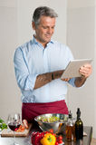 Modern chef with tablet Stock Photography