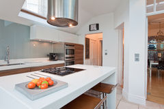 Modern chic fitted kitchen stock images