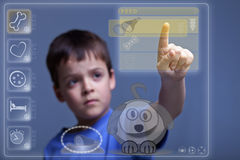 Modern child feeding virtual pet Stock Photos