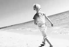 Free Modern Child In Colorful Shirt On Seashore Walking Royalty Free Stock Photos - 113296738